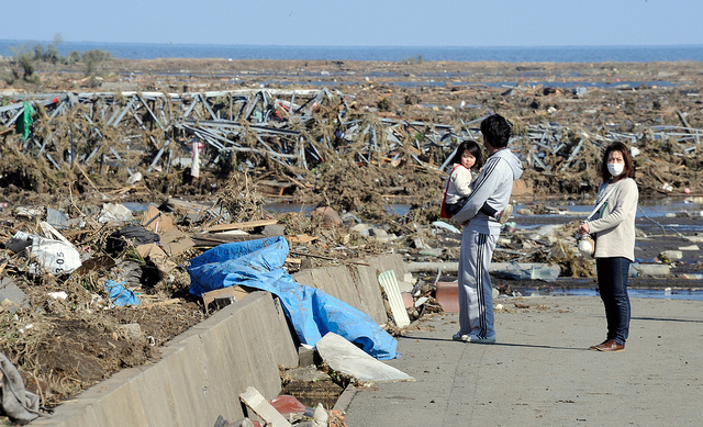 Local residents look at debris